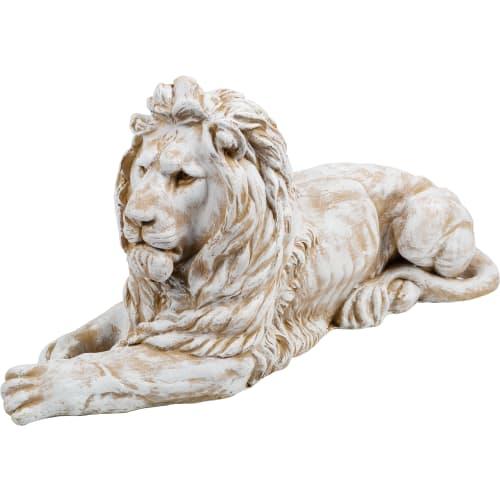 Фигура садовая Лев лежит 36x73 см смотрит влево